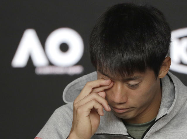 Japan's Kei Nishikori answers questions during a press conference after he retired injured from his quarterfinal against Serbia's Novak Djokovic at the Australian Open tennis championships in Melbourne, Australia, Wednesday, Jan. 23, 2019. (AP Photo/Kin Cheung)