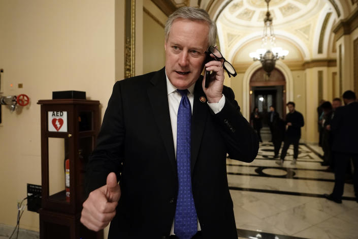 Rep. Mark Meadows, R-N.C., talks on the phone as the House of Representatives debates impeaching President Donald Trump on two charges, abuse of power and obstruction of Congress. (AP Photo/J. Scott Applewhite)