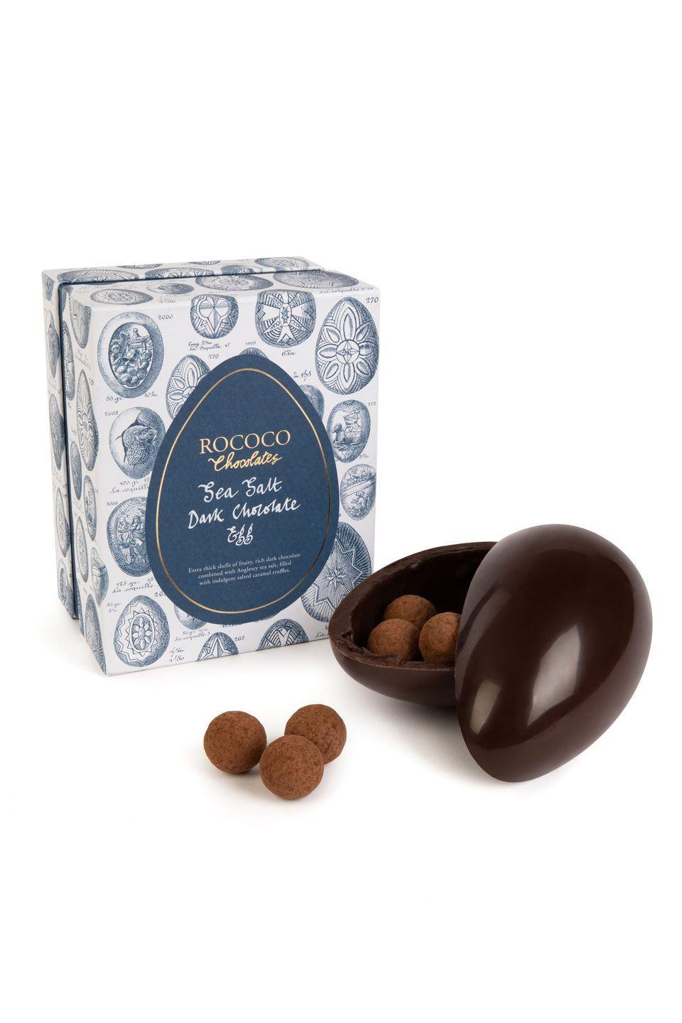 "<p>London luxury since 1983: Rococo's easter selection includes an indulgent sea salt dark chocolate egg, complete with truffles. Perfectly balanced with a touch of Anglesey sea salt, the inside hides a bag of delicious caramel truffles dusted with generous lashings of cocoa. Plus, it comes invitingly packaged in Royal-blue foil and a signature Rococo gift box. </p><p>£32.95, <a href=""https://www.rococochocolates.com/collections/easter-chocolates/"" rel=""nofollow noopener"" target=""_blank"" data-ylk=""slk:Rococo Chocolates"" class=""link rapid-noclick-resp"">Rococo Chocolates</a>.</p><p><a class=""link rapid-noclick-resp"" href=""https://www.rococochocolates.com/collections/easter-chocolates/"" rel=""nofollow noopener"" target=""_blank"" data-ylk=""slk:SHOP NOW"">SHOP NOW</a><br></p>"
