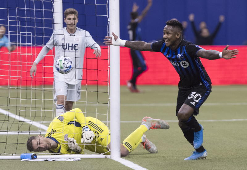 Montreal Impact's Romell Quioto (30) reacts after scoring against New England Revolution goalkeeper Matt Turner during the first half of an MLS soccer game in Montreal, Saturday, Feb. 29, 2020. (Graham Hughes/The Canadian Press via AP)