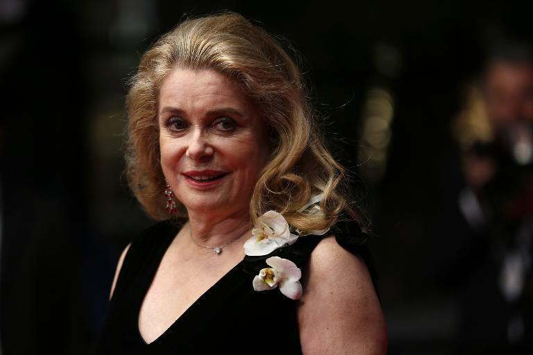 "A file picture taken on May 21, 2013 shows French actress Catherine Deneuve posing as she arrives for the screening of the film ""La Grande Bellezza"" (The Great Beauty) at the 66th edition of the Cannes Film Festival in Cannes"