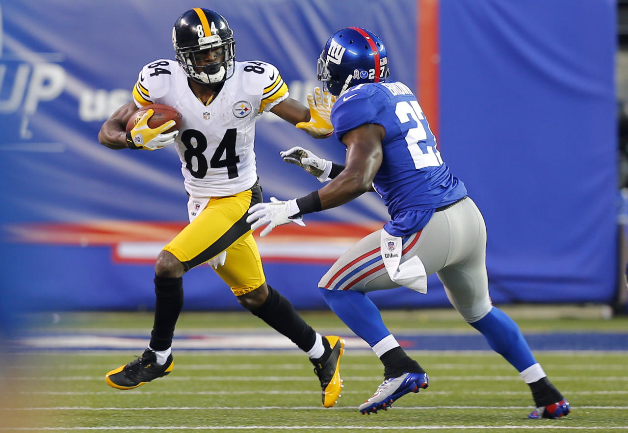 Nov 4, 2012; East Rutherford, NJ, USA;  Pittsburgh Steelers wide receiver Antonio Brown (84) turns up field after reception against New York Giants strong safety Stevie Brown (27) during the first half at MetLife Stadium. Mandatory Credit: Jim O'Connor-US PRESSWIRE