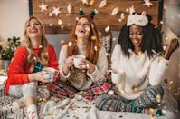 """<p>Everyone's bound to be feeling wiped out by the busy holiday season — and that's exactly why you should host a pajamas-required slumber party. Comfort will be key at <em>this</em> New Year's party, complete with soft blankets and warm PJ's, hot cocoa by the fire, and the best <a href=""""https://www.goodhousekeeping.com/holidays/g29700691/easy-new-years-eve-desserts/"""" rel=""""nofollow noopener"""" target=""""_blank"""" data-ylk=""""slk:New Year's desserts"""" class=""""link rapid-noclick-resp"""">New Year's desserts</a>. </p>"""