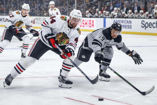 Chicago Blackhawks defenseman Calvin de Haan (44) vies with Los Angeles Kings forward Alex Iafallo (19) for the puck during the first period of an NHL hockey game Saturday, Nov. 2, 2019, in Los Angeles. (AP Photo/Ringo H.W. Chiu)