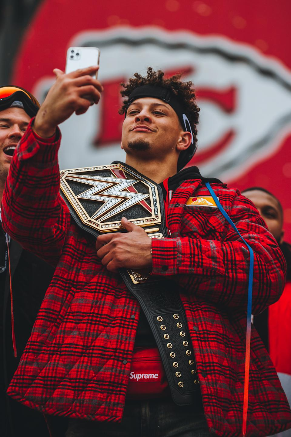 Kansas City Chiefs QB Patrick Mahomes poses with a custom-made WWE championship belt days after winning Super Bowl LIV. (Photo credit: Kansas City Chiefs)