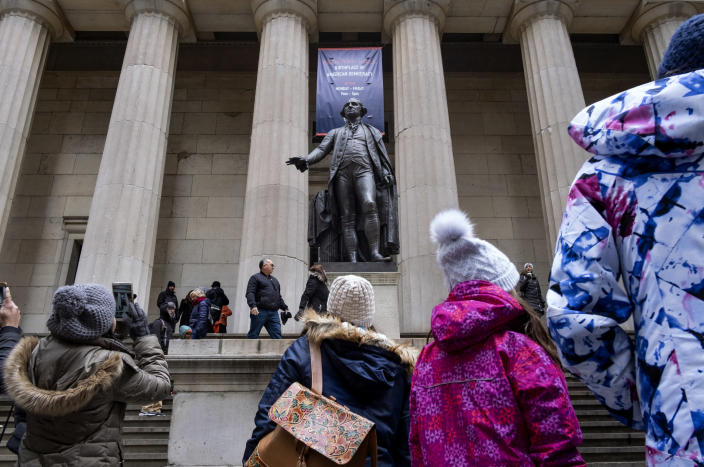 People stand near a statue of George Washington on Dec. 22, 2018, at the closed Federal Hall National Memorial in New York. (Photo: Craig Ruttle/AP)
