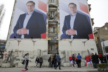 People pass posters of Serbian Prime Minister Aleksandar Vucic, in Novi Sad, Serbia March 18, 2017. Picture taken March 18, 2017. REUTERS/Marko Djurica
