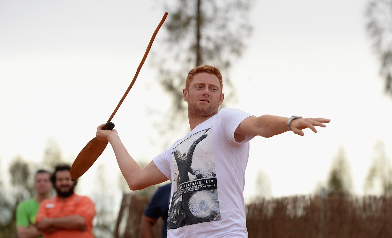 AYERS ROCK, AUSTRALIA - NOVEMBER 26: Jonathan Bairstow of England throws a spear during a team visit to Uluru, which is also known as Ayers Rock, on November 26, 2013 in Ayers Rock, Australia.  (Photo by Gareth Copley/Getty Images)