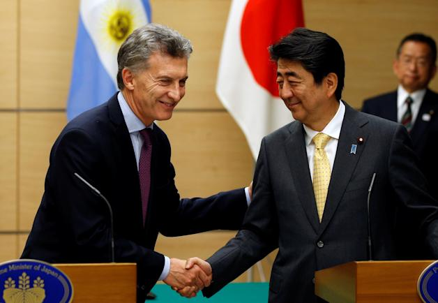 Argentina's President Macri shakes hands with Japan's PM Abe at Abe's official residence in Tokyo