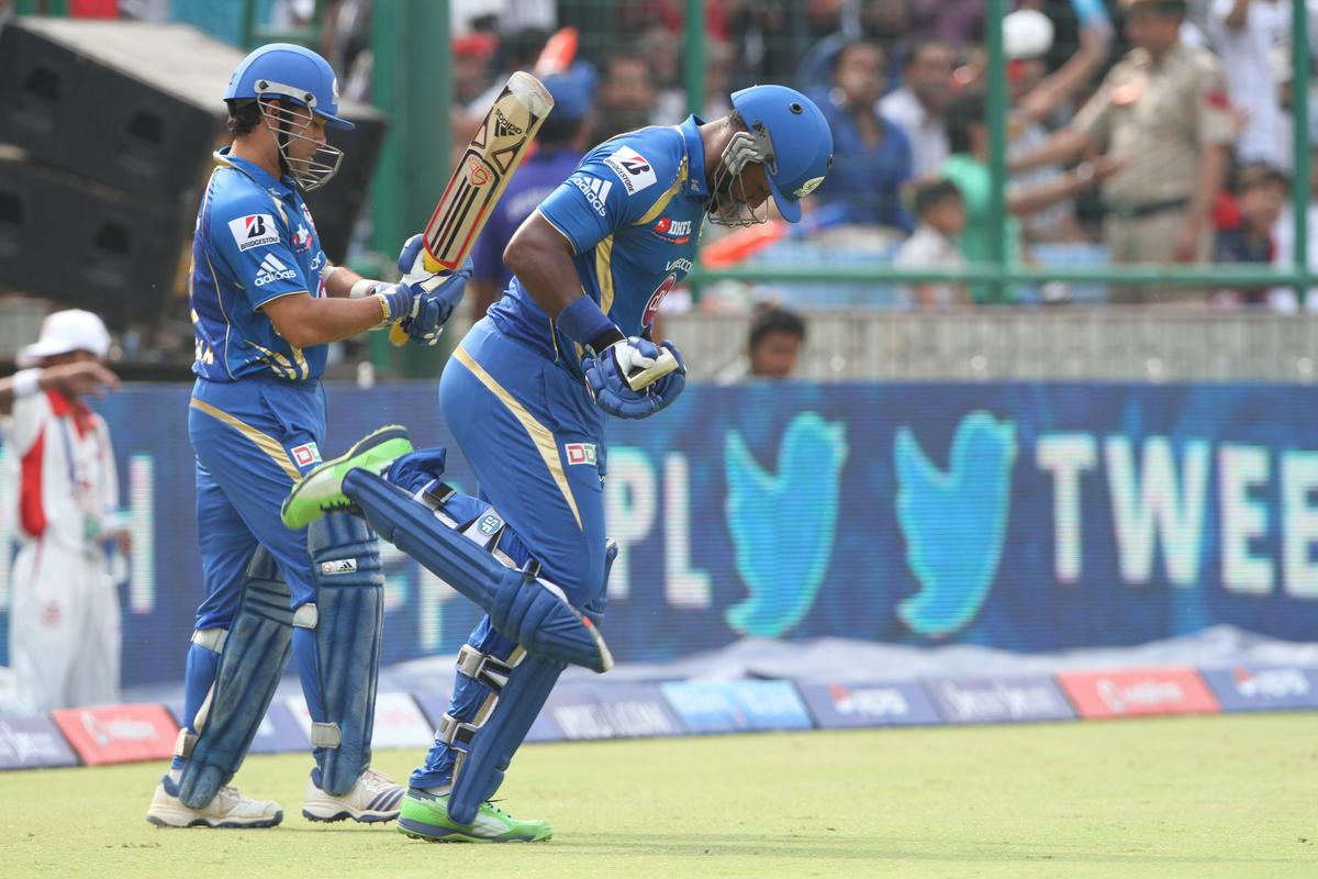 Mumbai Indian player Sachin Tendulkar and Mumbai Indian player Dwayne Smith going for a opening during match 28 of the Pepsi Indian Premier League between The Delhi Daredevils and the Mumbai Indians  held at the Feroz Shah Kotla Stadium, Delhi on the 21st April 2013..Photo by Deepak Malik-IPL-SPORTZPICS ..Use of this image is subject to the terms and conditions as outlined by the BCCI. These terms can be found by following this link:..https://ec.yimg.com/ec?url=http%3a%2f%2fwww.sportzpics.co.za%2fimage%2fI0000SoRagM2cIEc&t=1496057669&sig=nMbZ6p2yAO28cF91QRNyBQ--~C