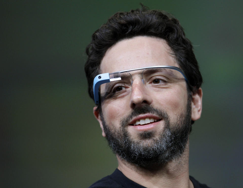 <p> FILE - This June 27, 2012 file photo shows Google co-founder Sergey Brin demonstrating Google's new Glass, wearable internet glasses, at the Google I/O conference in San Francisco. Google is starting to notify 8,000 people who will be invited to buy a test version of the company's much-anticipated Internet-connected glasses for $1,500. The invitations are being sent to the winners of a contest conducted a month ago. Google asked U.S. residents to submit applications through Twitter or its Plus service to explain in 50 words or less how they would use a technology that is being hailed as the next breakthrough in mobile computing. (AP Photo/Paul Sakuma, file)</p>