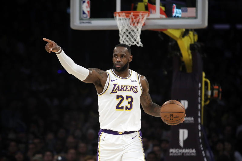 Los Angeles Lakers' LeBron James (23) dribbles down court against the Dallas Mavericks during the first half of an NBA basketball game Sunday, Dec. 1, 2019, in Los Angeles. (AP Photo/Marcio Jose Sanchez)