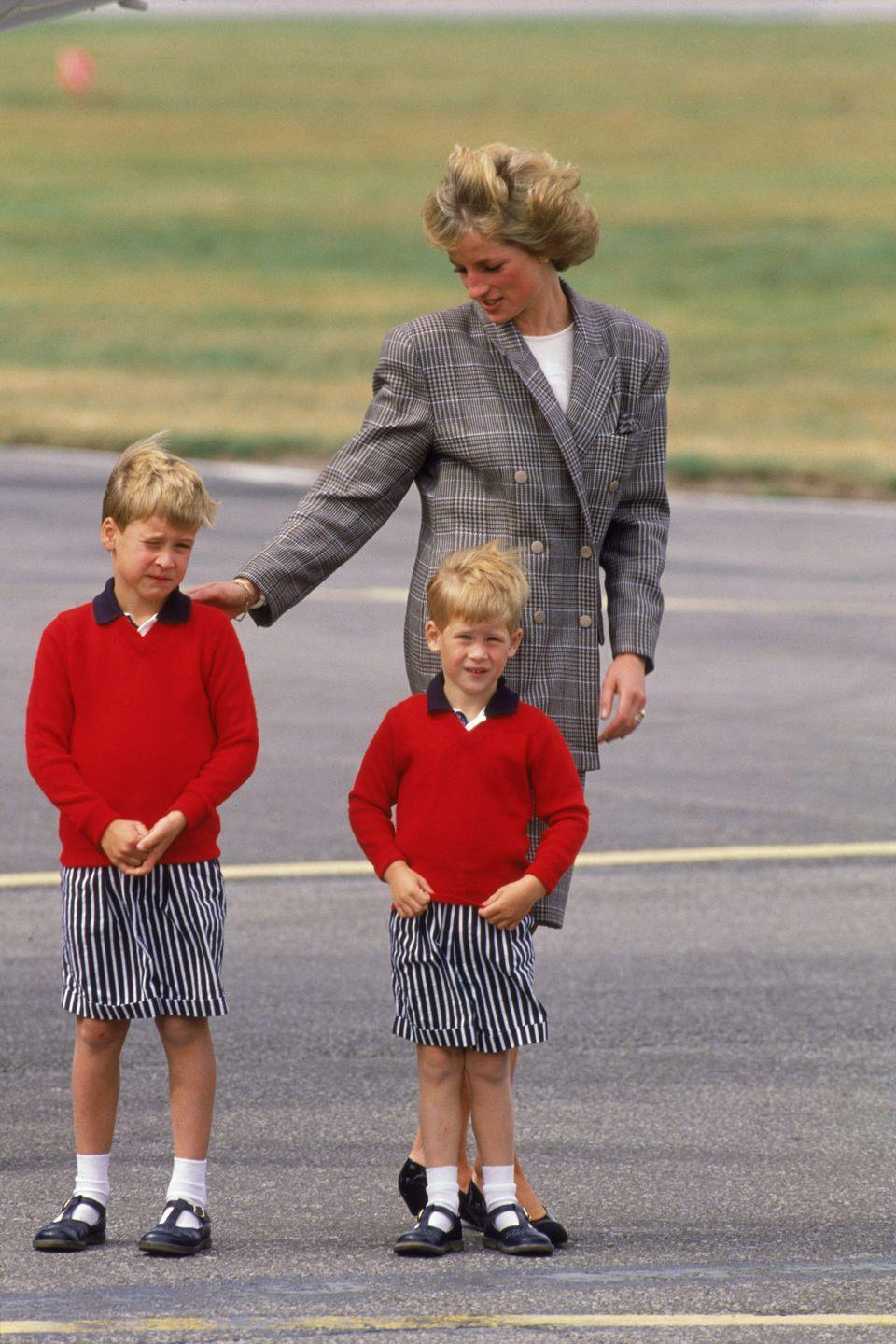 <p>Harry matches with William in striped shorts and red sweaters as they arrive at Aberdeen airport with Princess Diana.</p>