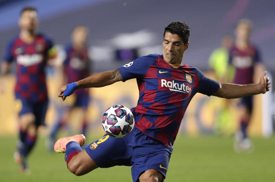 Barcelona's Luis Suarez kicks the ball during the Champions League quarterfinal match between FC Barcelona and Bayern Munich at the Luz stadium in Lisbon, Portugal, Friday, Aug. 14, 2020. (AP Photo/Manu Fernandez/Pool)