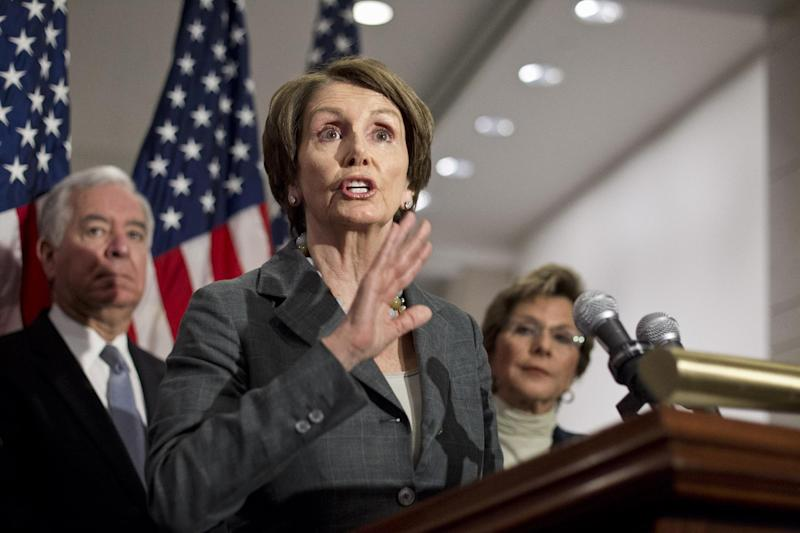 House Minority Leader Nancy Pelosi of Calif., center, accompanied by Rep. Nick Rahall II, D-W.Va., and Senate Environment and Public Works Committee Chair Sen. Barbara Boxer, D-Calif., gestures during a news conference on Capitol Hill in Washington, Thursday, March 22, 2012, to urge the Republican leadership to take up the bipartisan Senate transportation bill. (AP Photo/J. Scott Applewhite)