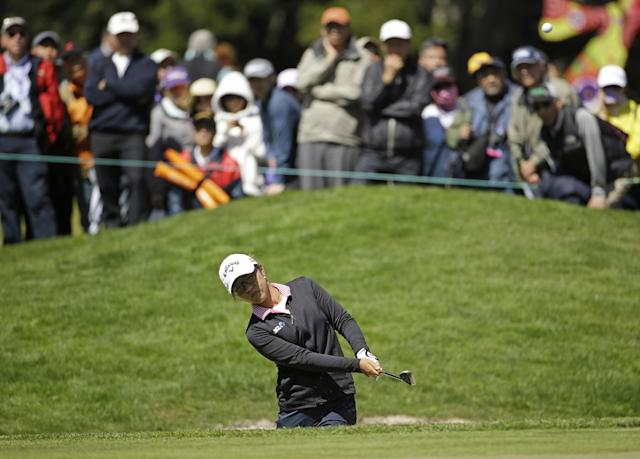 Lydia Ko, of New Zealand, hits out of a bunker onto the sixth green of Lake Merced Golf Club during the final round of the Swinging Skirts LPGA Classic golf tournament on Sunday, April 27, 2014, in Daly City, Calif. (AP Photo/Eric Risberg)