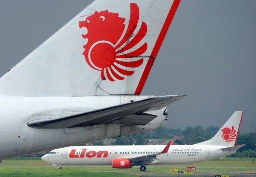 A Lion Air airplane lands at Sukarno Hatta airport in Tangerang