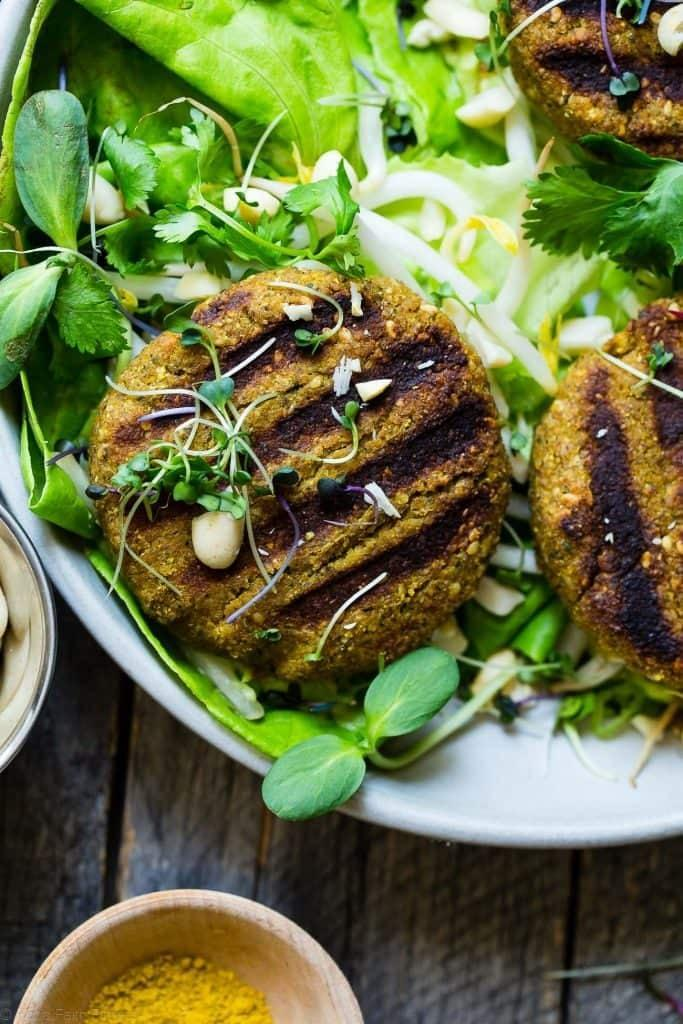"<p>Under 250 calories, these vegan veggie burgers have a Thai peanut kick and curry twist that make it all kinds of savory. Add fresh vegetables on top of each patty to make them even better.</p> <p><strong>Get the recipe</strong>: <a href=""https://www.foodfaithfitness.com/thai-veggie-burger-recipe-curry/"" class=""link rapid-noclick-resp"" rel=""nofollow noopener"" target=""_blank"" data-ylk=""slk:Thai curry grilled veggie burgers"">Thai curry grilled veggie burgers</a></p>"