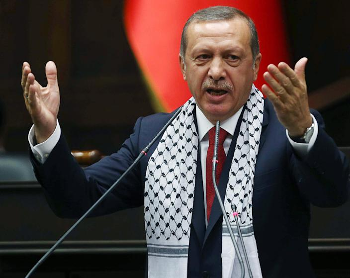 Turkish Prime Minister Recep Tayyip Erdogan addresses members of parliament from his ruling Justice and Development party (AKP) during a meeting at the Turkish parliament in Ankara on July 22, 2014 (AFP Photo/Adem Altan)