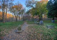 """<p><strong>Bachelor's Grove Cemetery - Midlothian, IL</strong></p><p>The center of many paranormal investigations and spooky television shows rests in an old plot of land just south of the Chicago bustle. The cemetery serves as the final resting place for <a href=""""https://sites.google.com/site/bachelorsgrovecemetery/history"""" rel=""""nofollow noopener"""" target=""""_blank"""" data-ylk=""""slk:nearly 200 souls,"""" class=""""link rapid-noclick-resp"""">nearly 200 souls,</a> with graves marking as far back as the early 1800s.</p><p>Photo: Wikimedia Commons/<a href=""""https://en.wikipedia.org/wiki/Bachelor%27s_Grove_Cemetery#/media/File:MG_9524_5_6_7_tonemapped-asm.jpg"""" rel=""""nofollow noopener"""" target=""""_blank"""" data-ylk=""""slk:Mark Bergner"""" class=""""link rapid-noclick-resp"""">Mark Bergner</a></p>"""