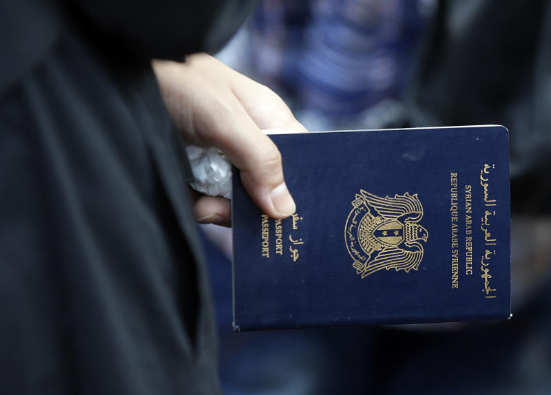 """A Syrian refugee holds her passport at the Turkish Cilvegozu gate border, Wednesday, Sept. 4, 2013. Russian President Vladimir Putin warned the West against taking one-sided action in Syria but also said Russia """"doesn't exclude"""" supporting a U.N. resolution on punitive military strikes if it is proved that Damascus used poison gas on its own people. (AP Photo/Gregorio Borgia)"""
