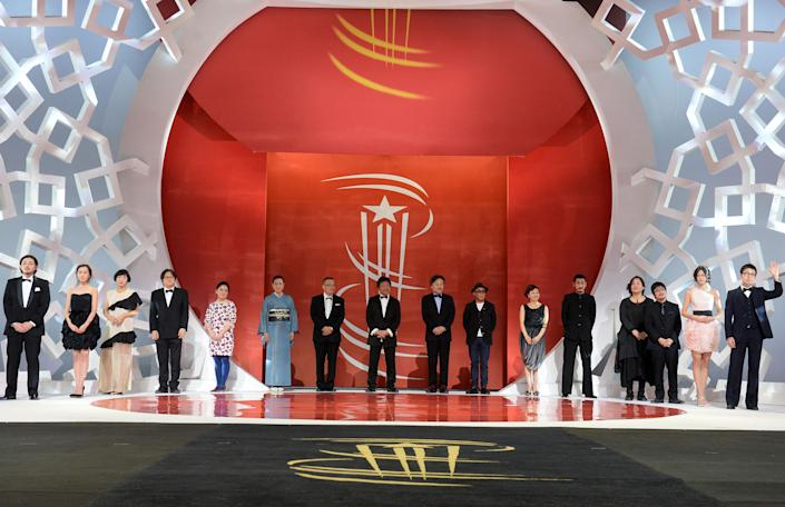 The Japanese delegation stands on stage during a tribute to Japanese Cinema at the 14th Marrakesh International Film Festival on December 9, 2014 in Marrakech (AFP Photo/Fadel Senna)