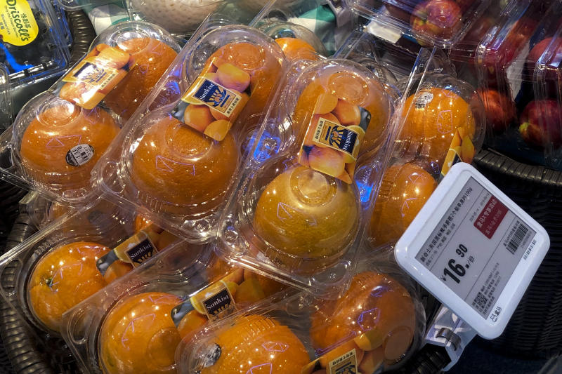 Oranges from the United States are on sale at a supermarket in Beijing, Tuesday, May 14, 2019. Sending Wall Street into a slide, China announced higher tariffs Monday on $60 billion worth of American goods in retaliation for President Donald Trump's latest penalties on Chinese products. (AP Photo/Andy Wong)