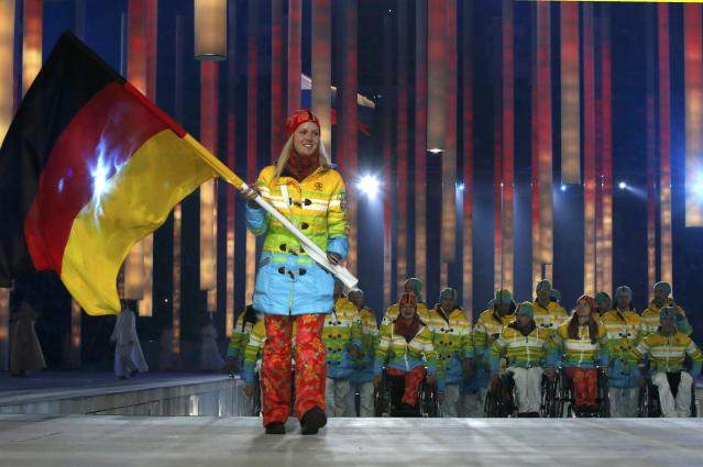 Germany's flag-bearer Andrea Rothfuss leads his country's contingent during the opening ceremony of the 2014 Paralympic Winter Games in Sochi, March 7, 2014. REUTERS/Alexander Demianchuk (RUSSIA - Tags: OLYMPICS SPORT)