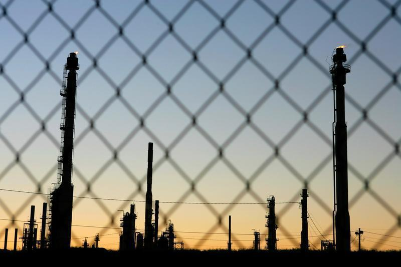 Flares burn at the Murphy Oil Refinery in the St. Bernard Parish of New Orleans, Louisiana on Octobe..
