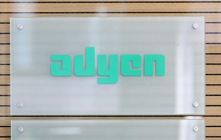 The Adyen logo is seen at the reception desk of the company's headquarters in Amsterdam