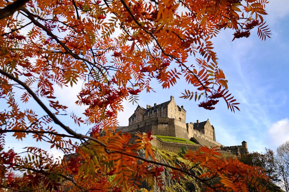 A view of Edinburgh Castle through the Rowan trees displaying their autumn colours in Princes Street Gardens. (Photo by Jane Barlow/PA Images via Getty Images)