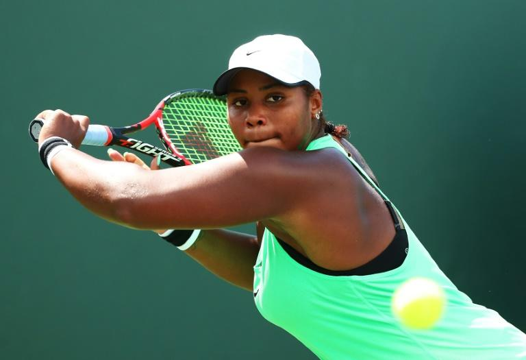 Taylor Townsend returns a shot against Roberta Vinci of Italy during day 5 of the Miami Open at Crandon Park Tennis Center on March 24, 2017 in Key Biscayne, Florida