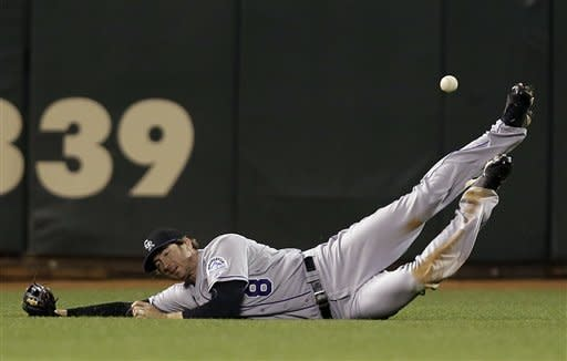 Colorado Rockies left fielder Charlie Blackmon (8) cannot make a diving catch on a fly ball by San Francisco Giants' Angel Pagan during the eighth inning of a baseball game on, Tuesday, Sept. 18, 2012 in San Francisco. Pagan drove in a run with a triple on the play. (AP Photo/Marcio Jose Sanchez)