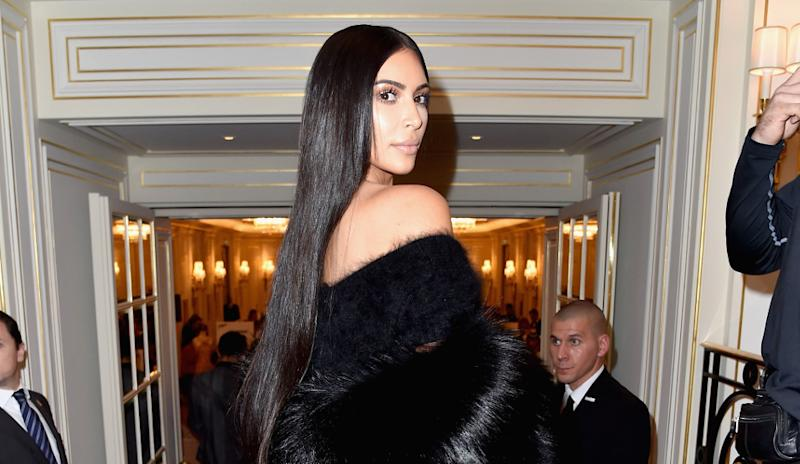 Kim Kardashian flaunts lip ring at Kris Jenner's Christmas party