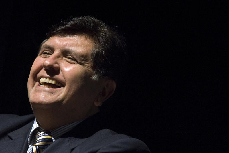 FILE - In this Sept. 18, 2008 file photo, Peru's President Alan García smiles during the opening ceremony of Expo Peru 2008 in Sao Paulo, Brazil. Current Peruvian President Martinez Vizcarra said Garcia, the 69-year-old former head of state died Wednesday, April 17, 2019, after undergoing emergency surgery in Lima. Garcia shot himself in the head early Wednesday as police came to detain him in connection with a corruption probe. (AP Photo/Andre Penner, File)