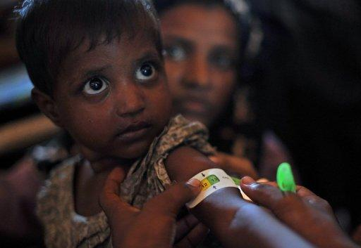 A Muslim Rohingya child receives medical care at a clinic on the outskirts of Sittwe on November 2. The UN's refugee agency has begun airlifting tents to provide shelter for thousands of people displaced by sectarian unrest in Myanmar's western Rakhine State