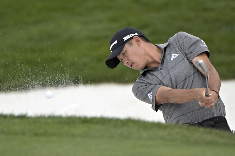 Collin Morikawa hits out of a bunker onto the 14th green during the final round of the Arnold Palmer Invitational golf tournament, Sunday, March 8, 2020, in Orlando, Fla. (AP Photo/Phelan M. Ebenhack)