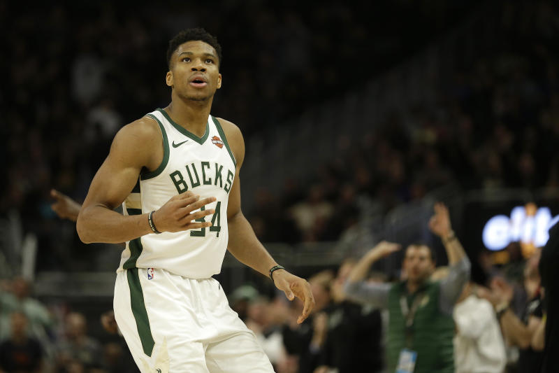 Bucks win 9th in a row with 111-102 victory over Hawks