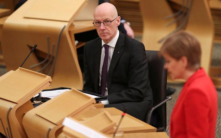 John Swinney, the education secretary, said a phased return was likely - Russell Cheyne/PA