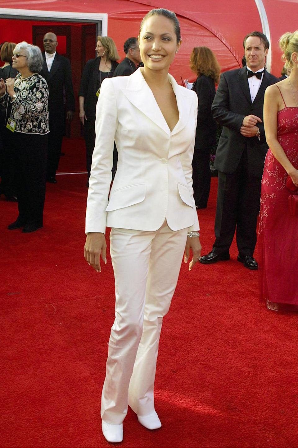 <p>Fresh off her 2000 Oscar win for Best Supporting Actress, Angelina Jolie rocked a white suit and a sleek ponytail. </p>