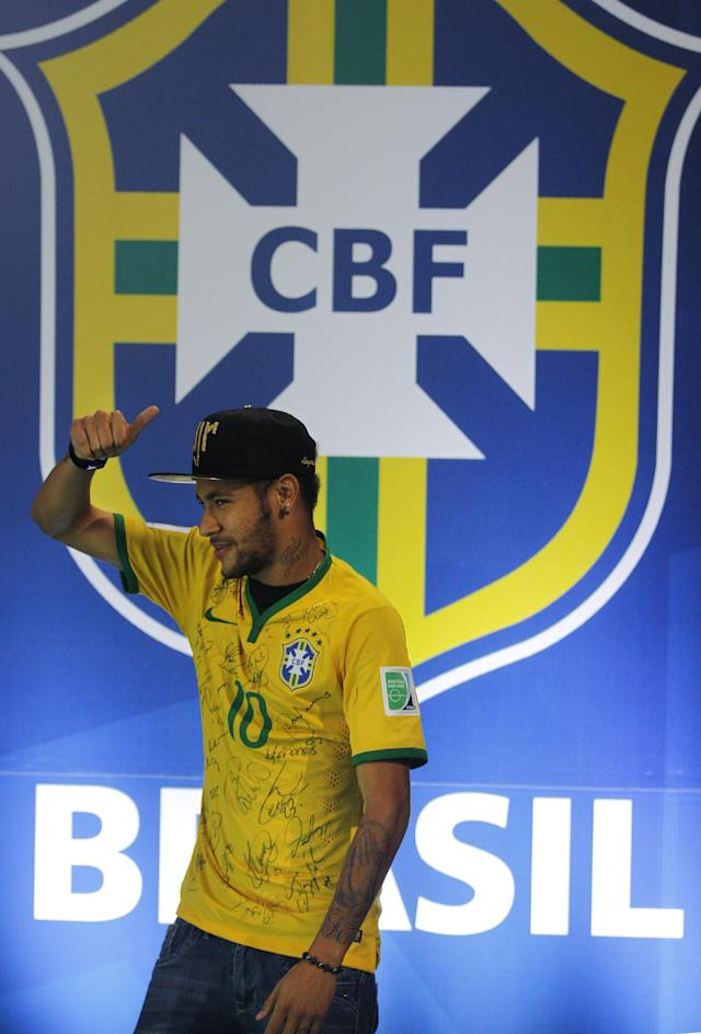 Brazil's Neymar gives the thumbs up, as he leaves after a press conference at the Granja Comary training center in Teresopolis, Brazil, Thursday, July 10, 2014. The Brazilian soccer star is back on his feet after suffering a broken vertebrae during a World Cup soccer match against Colombia. Brazil will be disputing a third place finish, without its star on Saturday. (AP Photo/Leo Correa)