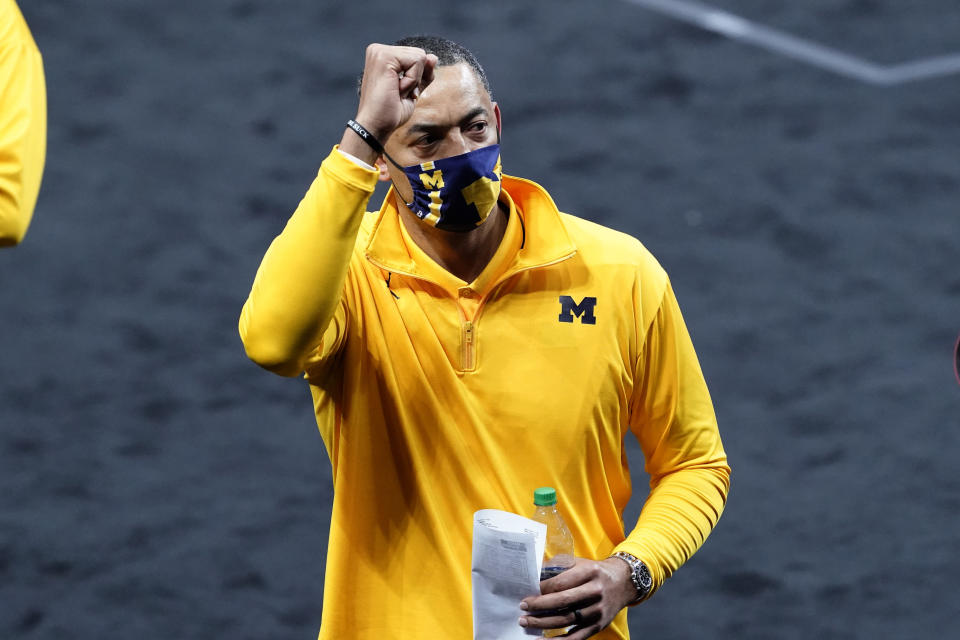 Michigan head coach Juwan Howard celebrates as he walks off the court after a second-round game against LSU in the NCAA men's college basketball tournament at Lucas Oil Stadium Monday, March 22, 2021, in Indianapolis. Michigan won 86-78. (AP Photo/AJ Mast)
