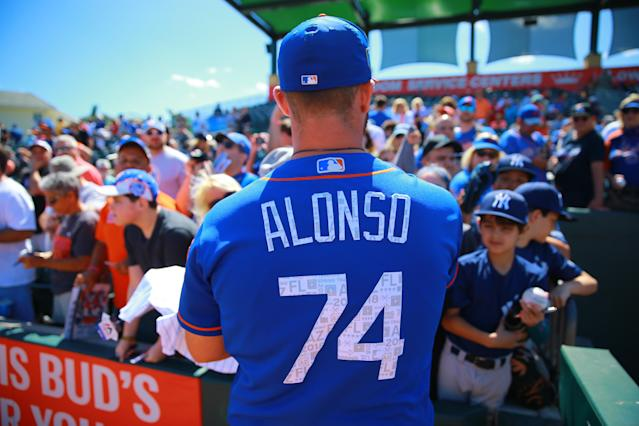 <p>New York Mets minor leaguer and Florida native Peter Alonso (74) signs autographs for fans before the baseball game against the Miami Marlins at Roger Dean Chevrolet Stadium in Jupiter, Fl., March 3, 2018. (Photo: Gordon Donovan/Yahoo News) </p>