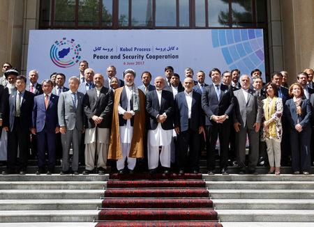 Afghan President Ashraf Ghani (C) poses for a group photo during a peace and security cooperation conference in Kabul, Afghanistan June 6, 2017. REUTERS/Omar Sobhani