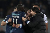 Porto's coach Sergio Conceicao, right, talks to Moussa Marega, left, during a Portuguese league soccer match between Vitoria SC and FC Porto in Guimaraes, Portugal, Sunday, Feb. 15, 2020. The president and the prime minister of Portugal have added their voices to a national outcry over racist abuse aimed at Moussa Marega who walked off the field after hearing monkey chants. (AP Photo)