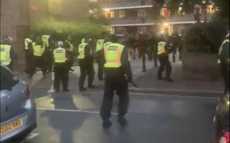 Officers were driven out of an estate in west London by a crowd of people throwing projectiles - TWITTER