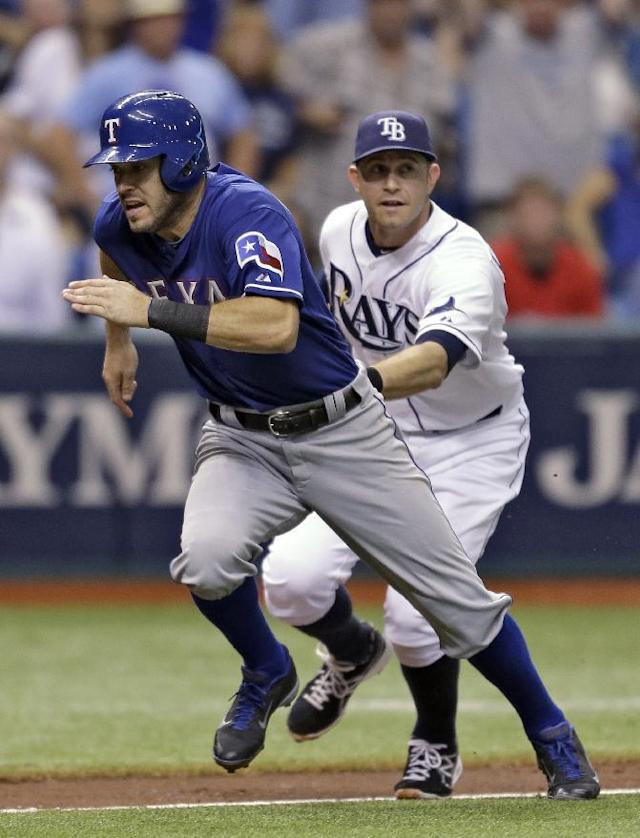 Texas Rangers' Ian Kinsler, left, gets tagged out by Tampa Bay Rays third baseman Evan Longoria after getting caught in a fourth-inning rundown on a fielder's choice by Rangers' Alex Rios during a baseball game Monday, Sept. 16, 2013, in St. Petersburg, Fla. (AP Photo/Chris O'Meara)