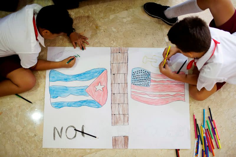 FILE PHOTO: Children draw flags from Cuba and the U.S. during the XIV Civil Society Forum against the 55-year-long standing U.S. economic and trade embargo against Cuba in Havana