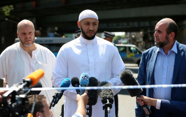 Mohammed Mahmoud (centre), an imam at Finsbury Park Mosque in London, saved the attacker who drove his van into a group of Muslims on Monday, witnesses say