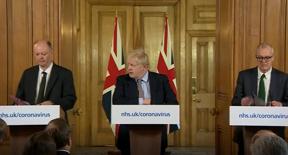A screen-grab of Prime Minister Boris Johnson (centre) speaking at a media briefing in Downing Street, London, on Coronavirus (COVID-19) after he had taken part in the government�s COBRA meeting. Standing with him are Chief Medical Officer, Chris Whitty (left) and Chief Scientific Adviser Sir Patrick Vallance (right). Picture date: Monday March 16, 2020. See PA story HEALTH Coronavirus. Photo credit should read: PA Video/PA Wire